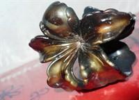 Cleste de par in forma de floare