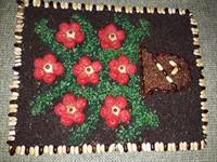 Tablou din seminte (flori rosii)